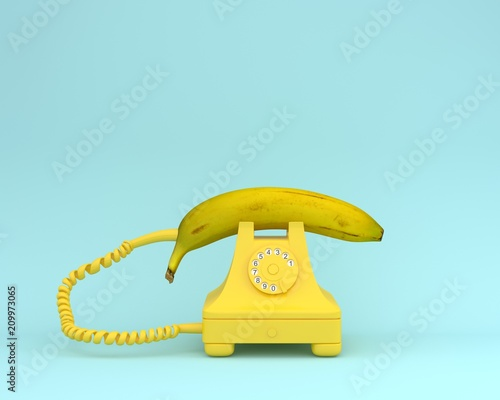 Creative idea layout fresh banana with yellow retro telephone on bluish background Fototapete