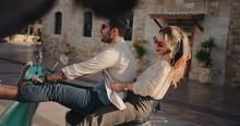 Young Tourists Couple Riding V...