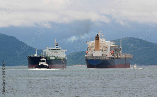 Two tankers pass each other in Santos port, Brazil