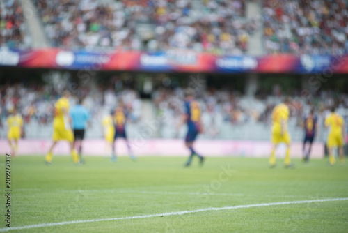Football players playing soccer. Blurred image Wallpaper Mural