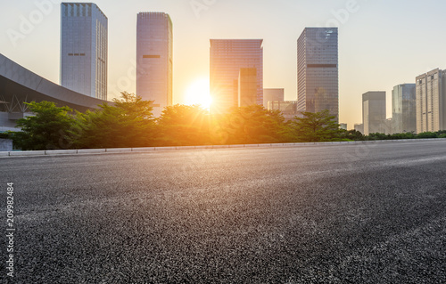 In de dag Centraal Europa Empty asphalt road and modern city commercial buildings at sunrise in Shenzhen