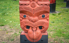 The Cropped Shot View Of The Traditional Maori Wood Carving Statue In Civic Square Of Hastings, New Zealand.