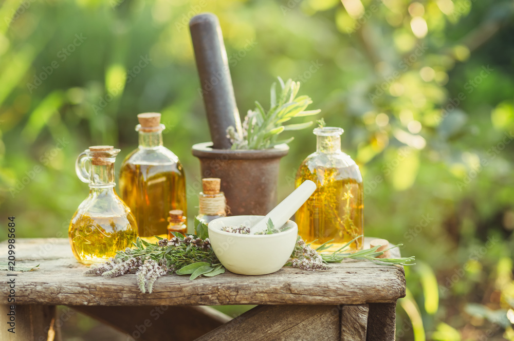 Fototapety, obrazy: Various massage and cosmetic oils in glass bottles