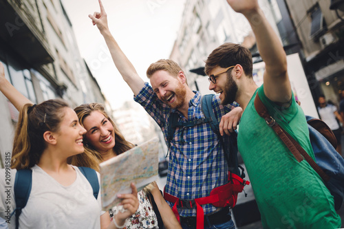 Papiers peints Kiev Happy group of tourists traveling and sightseeing
