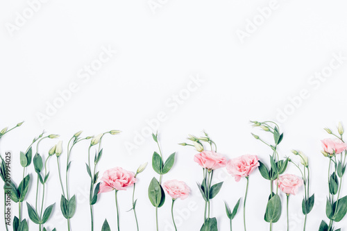 Fotobehang Bloemen Floral bottom border frame made of pink eustomas