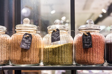 Sesame Seeds In Glass Jars On Display In A French Supermarket. Paris, France