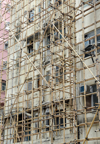 In Hong Kong and China and other parts of Asia, bamboo is often used for scaffol Poster