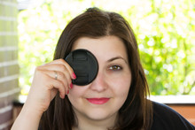 Young Brunette Girl With The Lens Cap