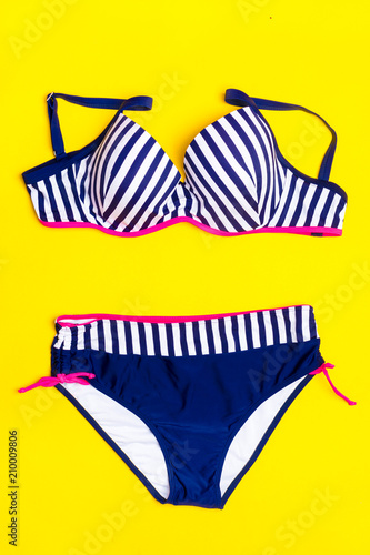 bf84310fc Fashion. Summer clothes, Accessories set- Trendy Swimsuit Bikini on the  yellow background. Beach Outfit. Flat lay.Creative Art. Hot Vibes.