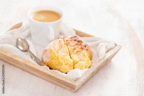 portuguese sweet bread pao de deus with cup of coffee Wallpaper Mural