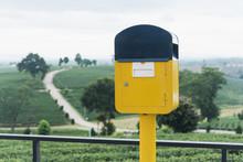 Yellow Mailbox On Tea Farm Background