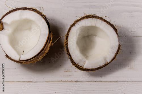 Fresh ripe coconut on white wooden table © olyasolodenko
