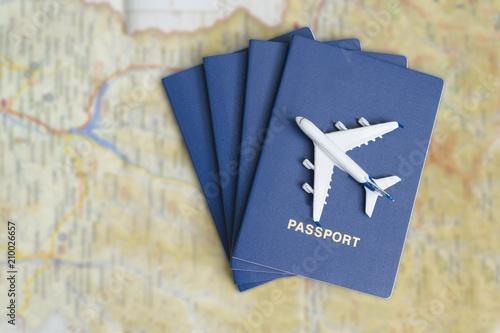 Photo  Airplane on the blue passports. Close up
