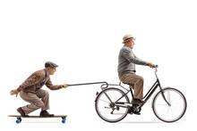 Senior Riding A Bike With Anot...