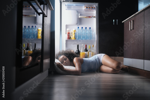 Fotografija Black Woman Awake For Heat Wave Sleeping in Fridge