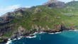 Aerial panoramic view of picturesque scenery of Hohoi Bay on Ua Pou island, volcanic coast - South Pacific Ocean, Marquesas Islands, landscape panorama of French Polynesia from above