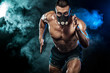 canvas print picture - Strong athletic man sprinter in training mask, running, fitness and sport motivation. Runner concept with copy space. Dynamic movement.
