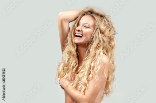 Staande foto Akt Beautiful woman with curly long blonde hair.