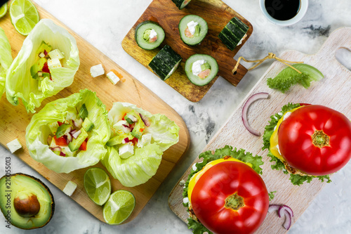 Photo Selection of low carb meal options - burger, taco, sushi