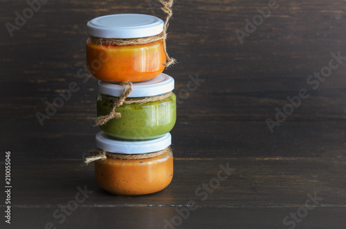 Foto op Aluminium Canarische Eilanden Several types of typical Canary Islands sauces in glass jar: Mojo picon, mojo verde made and almogrote are popular souvenirs of the fun holiday experience. Copy space