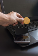 Cryptocurrency Called Bitcoin With Laptop And A Smartphone.
