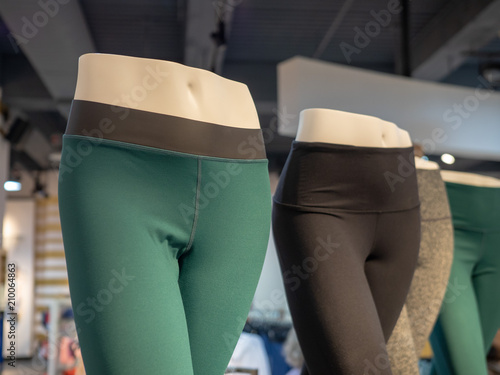 Plastic athletic mannequin lower bodies posing with yoga pants Fototapeta