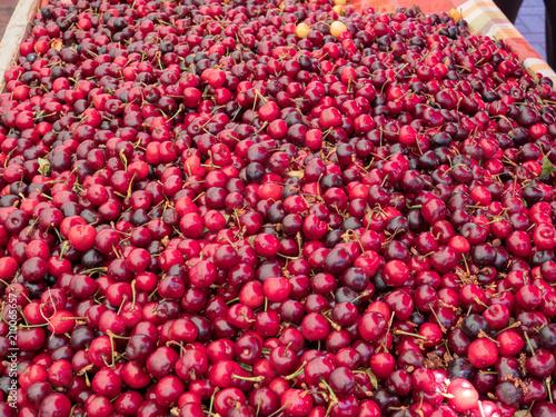 Deurstickers koffiebar Overhead shot of cherries on table in a marketplace