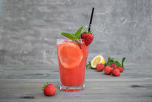 Fresh Pink Lemonade With Lemon, Lime And Strawberries
