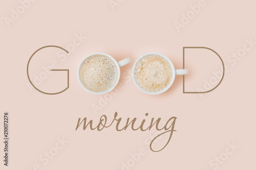 Fotografia Good morning card with Coffee cups on pale pink background