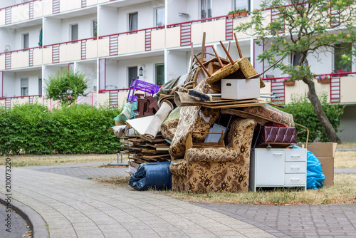 Obraz Big pile of old furniture and household goods on the roadside - fototapety do salonu
