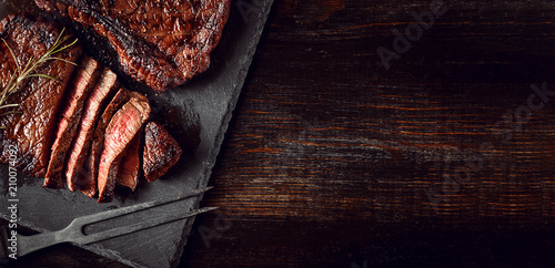 Aluminium Prints Steakhouse dinner for two with steaks and red wine