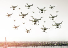 Swarm Of Drones Flying Over The City