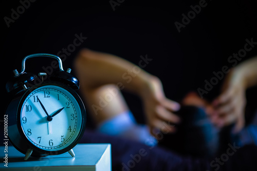 Fotografia, Obraz  asian man in bed suffering insomnia and sleep disorder thinking about his proble