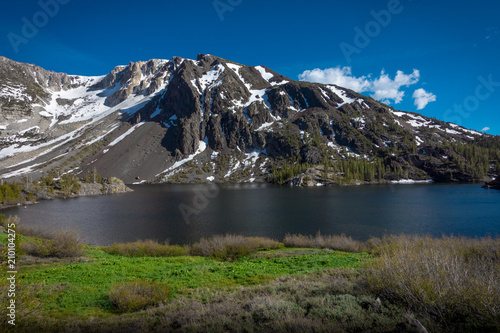 Foto op Aluminium Meer / Vijver Ellery Lake and Snow Covered Mountain in Yosemite National Park