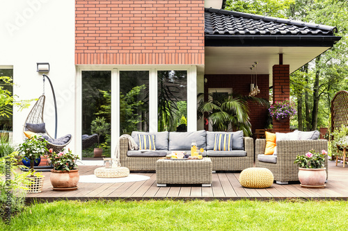 Fotografía  Real photo of a beautiful terrace with garden furniture, plants and swing