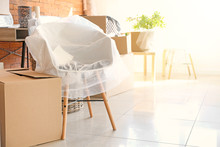 Interior Items And Packed Carton Boxes In Room. Moving House Concept