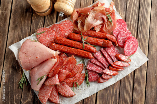 Fotografie, Obraz  Variety of delicious deli meats on wooden table
