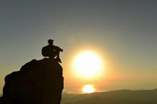 Climber Watching The Sunrise O...