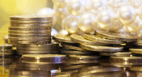 Fototapeta Wealth, luxury concept - gold money coins with white pearls obraz