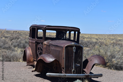 Photo  Classic Rusted Out Car on Route 66 in Arizona
