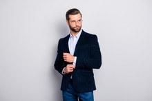 Portrait Of Elite Elegant Attractive Dreamy Fashionable Groomed Entrepreneur Wearing Dark Blue Velvet Jacket Checkered Shirt Correcting Fixing Cufflinks On Sleeves Isolated On Gray Background