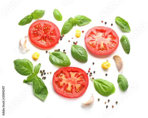 Fotografija Composition with spices and tomatoes on white background