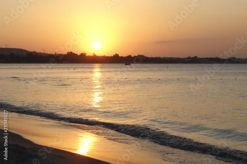 In de dag Ochtendgloren sunrise by the sea, shore silhouette and bright orange sky, Tunisia