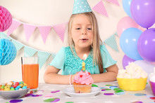 Little Girl Blowing Out Candle...
