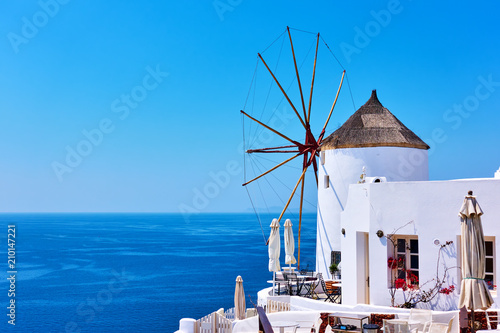 Foto op Canvas Mediterraans Europa Old white windmill near sea