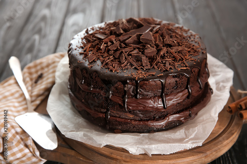 Photo Board with delicious chocolate cake on wooden table