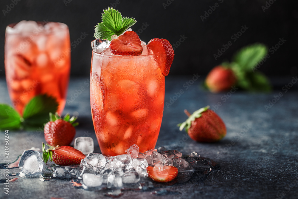 Fototapeta Fresh strawberry cocktail. Fresh summer cocktail with strawberry and ice cubes. Glass of strawberry soda drink on dark background.