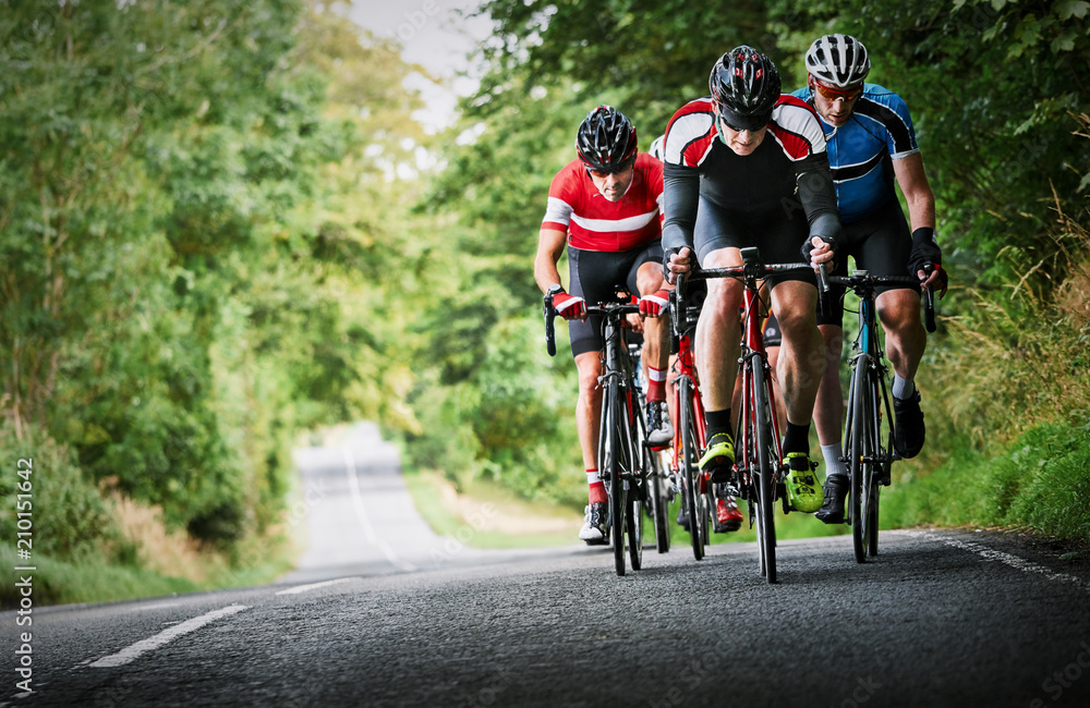 Fototapeta Cyclists racing on country roads on a sunny day in the UK.