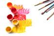 Leinwanddruck Bild - Jars with paints and brushes on white background