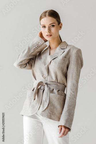beautiful young woman in stylish vintage jacket looking at camera isolated on white Wall mural